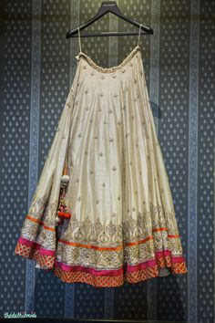 raw silk gota patti lehenga in ivory orange and pink by Anita Dongre