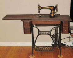 If you've inherited an antique sewing machine, how can you identify the model and the mystery parts left in its drawers?