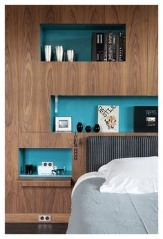 Built in wall shelves are a great idea for storing items and it looks good too, especially with the painted wall to add a splash of colour
