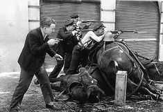 Agusti Centelles - Soldiers firing from behind a barricade of dead horses, Barcelona, 1936.