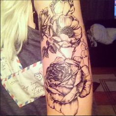 Phase 1: Floral Half sleeve. Inspired by old botanical drawings. Done by Luc Suter of Black Diamond, Venice, Los Angeles CA  Lini based tattoos, black and gray tattoos, rose tattoo, poppy tattoo.