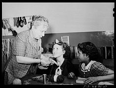 [poor focus, but better light on the African-American girl] 1942 knitting class at Red Hook Community Center, Brooklyn.