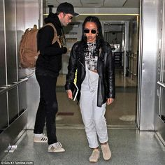 Couple's trip: Robert Pattinson, 30, and FKA Twigs, 28, were returned to LAX on Monday