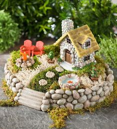 I like the rock sides of this round fairy garden