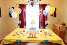 A rubber ducky birthday party dessert table I created.