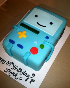 BMO Adventure Time Cake. I love Adventure time and I want to try and do something like this in class. I would have to use a lot of fondant tough.