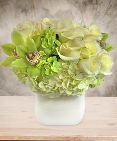 Nothing says elegance more than the beauty of a white floral bouquet. The Simple Elegance Bouquet says it all with white and green hydrangeas, cymbidium orchids, white roses and white mini callalilies, beautifully displayed in a white...