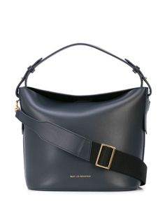 Navy blue leather Cambria tote from Want Les Essentiels De La Vie featuring an adjustable shoulder strap, a top magnetic closure, a flat top handle and a front centre logo stamp. Want Les Essentials, Crossbody Bag, Tote Bag, Logo Stamp, Italian Leather, Bucket Bag, Dust Bag, Shoulder Strap, Black Leather