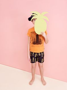 Katrina Tang Photography for Babesta boutique NY SS 14. Boy holding a pineapple, beachwear #katrinatang #tangkatrina