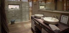 Damaraland Camp, Torra Conservancy offers spacious adobe-styled, thatched units in the most pristine wilderness area of Namibia. Camps, Wilderness, Safari, Vanity, Shower, Bathroom, Skeleton, Coast, Dressing Tables