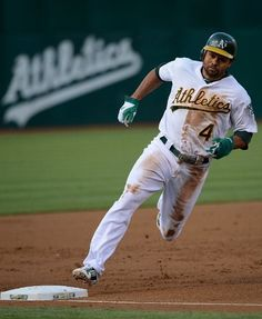OAKLAND, CA - JUNE 15: Coco Crisp #4 of the Oakland Athletics rounds third to score on a two run triple by Josh Reddick in the first inning against the San Diego Padres at O.co Coliseum on June 15, 2012 in Oakland, California. (Photo by Thearon W. Henderson/Getty Images)
