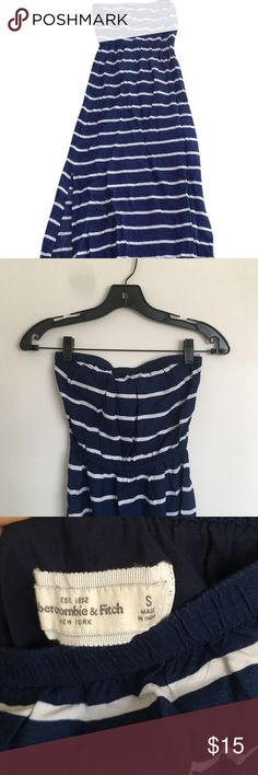 Striped Maxi White and Navy Strapless Dress It has a band at the top, and a band at the waist.  Maxi dress, with small slits around the ankles  Excellent condition Abercrombie & Fitch Dresses Maxi