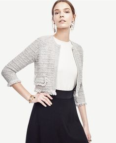 """Shimmering sequins add sparkling personality to our rich zebra jacquard sweater. Jewel neck. Long sleeves. 22 1/2"""" long."""