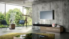 """Gramercy TV Stand. Create a wall unit to fit any size wall. The Gramercy combines a wood base with a lacquered mezzanine supported by a stainless steel leg. Lengthen (up to 135"""") or shorten (down to 95"""") the overall unit by adjusting the position of the mezzanine unit, allowing you great flexibility to accommodate any wall size."""