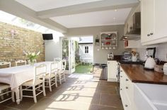 What is subtly prominent in the photo above is the reflection of the chairs and table on the paved floors. The fair faced brickwork really adds character to the space and there is a real feeling of connection between the kitchen & rear garden