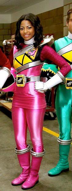 This is Shelby the Pink Dino Charge Ranger from Power Rangers: Dino Charge. Shelby is the 1st African American Pink Ranger in Power Rangers History!! Shelby is a rough-n-tumble 18-year-old tomboy who loves to get into the dirt. She's strong-willed, stubborn, and direct, which makes dating a challenge... for the boy.