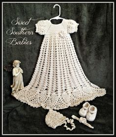This dress is made with a soft silky yarn and embellished with vintage lace style buttons for the back closure. The ecru color gives this