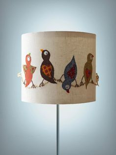 Cute bird lamp... maybe a wall hanging would be cute too.