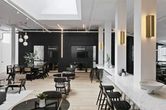 The New Work Projectin Brooklyn is a modern co-working space with a black and white interior design, made for creatives to get work done.