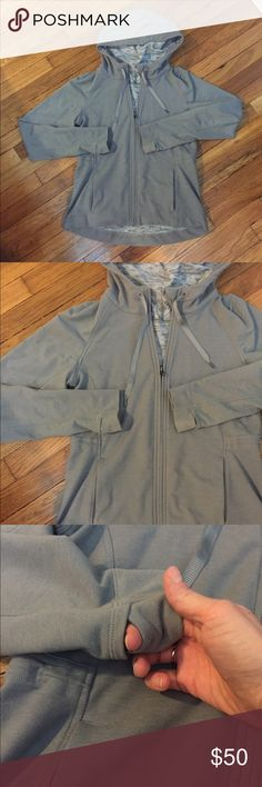 LuluLemon hoodie Grey hoodie. High-low, two front pockets, thumb holes and draw string hood. Mint condition. Doesn't have a tag but I believe it will fit medium to large. lululemon athletica Jackets & Coats