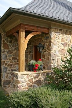 Stone cottage...I love the porch detailing!