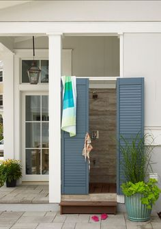 Forget the exposed plumbing and loose gravel underfoot this outdoor shower by Our Town Plans includes wood floors, stone siding, and pretty blue shutters. Perfect for balmy Summer nights. Source: Tria Giovan for Coastal Living Blue Shutters, Outside Showers, Outdoor Spaces, Coastal Living, House, Outdoor Baths, Colorful Interiors, Outdoor Shower, South Carolina Beach Houses