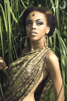 This beautiful African model would appeal to Beneatha's love for the culture introduced to her by Asagai. This model looks beautiful in a robe similar to Beneatha's new gift, and has short and natural hair. Her overall grace would probably inspire Beneatha to follow her creative dream of expressing herself uniquely as an intelligent but beautiful African American woman.