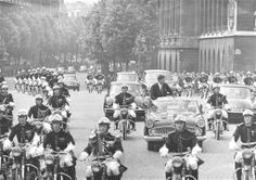 President Kennedy's Visit to France - May 31 - June 2, 1961 .~~ President John Kennedy stands up in his open car to wave to crowds in Paris on May 31, 1961 as motorcycle Gendarmes lead the way to the Quai D'Orsay on the way from the airport. French President Charles De Gaulle. ♡✿❀♡❁♡✾♡✽♡❃❃♡  http://en.wikipedia.org/wiki/John_F._Kennedy     http://en.wikipedia.org/wiki/Charles_de_Gaulle