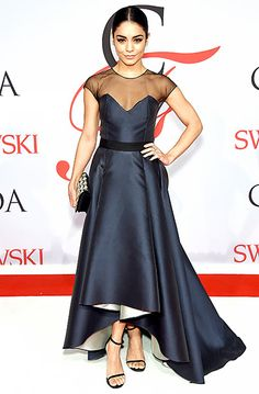 """Vanessa Hudgens, who's currently starring on Broadway in Gigi, channeled her classic character in a midnight blue Sachin & Babi Noir top and high-low skirt, the latter lined in cream. She added an embroidered clutch and Stuart Weiztman """"Nudist"""" heels."""