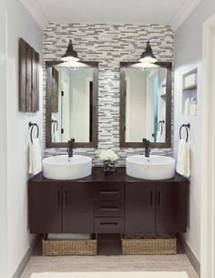 Double sinks, double mirrors and floating vanity.