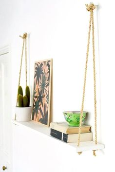 33 Gorgeous DIY Projects To Decorate Your Grown Up Apartment; Sisal rope to a painted board for a hanging shelf Diy Hanging Shelves, Floating Shelves Diy, Rope Shelves, Window Shelves, Shelf Wall, Wall Sconces, Diy Hacks, Organizing Hacks, Diy Home Decor On A Budget