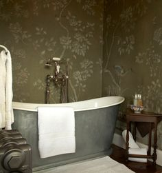 De Gournay Bath.  I think this is wallpaper but it would be even better hand painted....  the pattern could remain the same but the birds could vary more and each be unique.  Love the tone on tone silver quality it has.
