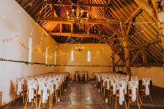 A shot of a beautiful rustic and lace ceremony set up by BenjaminStuart at Ufton Court #barnwedding