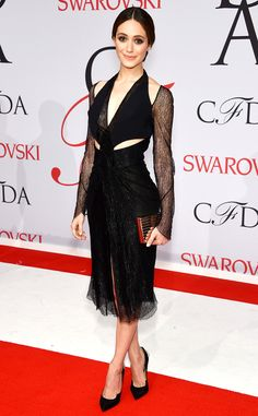 2015 CFDA: Emmy Rossum is wearing a black lace Dion Lee dress with sheer long sleeves, deep V- neckline, and cutouts. I love the edge with this dress! I love the cutouts. Not too overwhelming which is good.