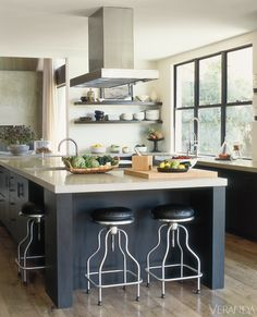 Open shelves give this kitchen an airy feeling.Stools, Design Within Reach. Cushions in Caldelle leather. Hood, Modern-Aire. Fittings, Dornbracht. Counters, Advanced Concrete Enhancement. Flooring, Exquisite Surfaces. Image originally appeared in the July/August 2011 issue of Veranda.INTERIOR DESIGN BY VANESSA ALEXANDER   - Veranda.com