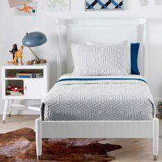 DwellStudio Bed also comes in Twin Size! Love this all white kids room with pop of peacock blue, vintage lamp and cow skin rug. | ella+elliot | Toronto | Vancouver | Canada | #ellaandelliot #dwellstudio #bedroominspiration #girlsroom | via @ellaandelliot Instagram
