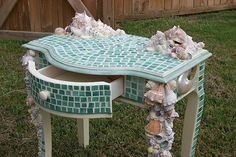 I don't like this exact style bit i do like the mosaic tile idea! Stained glass and shell, mosaic table. - edit, edit, edit: needs fewer shells, but gorgeous Mosaic Crafts, Mosaic Projects, Mosaic Art, Mosaic Glass, Mosaic Tiles, Stained Glass, Mosaic Furniture, Funky Furniture, Furniture Projects