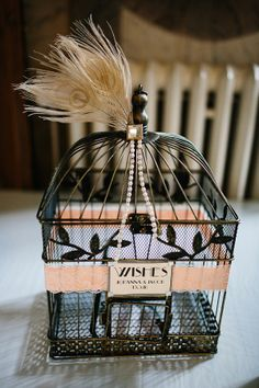 Stylish black birdcage and feather decor to collect cards from wedding guests. Old Hollywood, Roaring Vintage Inspired Wedding Roaring 20s Wedding, Great Gatsby Wedding, Gatsby Theme, Vintage Wedding Theme, Art Deco Wedding, Wedding Blog, Dream Wedding, Wedding Ideas, 1920s Wedding