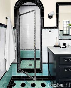 The bold use of tilework in these two bathrooms may look original to the 1930s, but every square foot is all new. See how designer Madeline Stuart gave these completely-renovated bathrooms a vintage feel.  House Beautiful