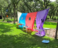 buy colorful plastic tablecloths from the Dollar Tree and hang them from a rope for big visual impact.