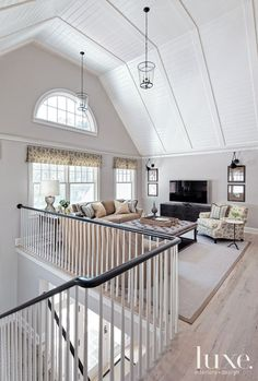 I like the railing with white spindles and a top that matches our wood floors