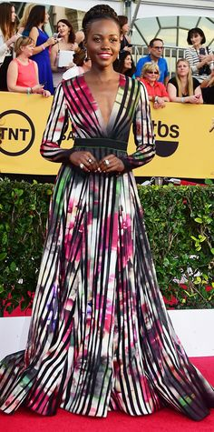 Lupita Nyong'o looks amazing in this water color and striped gown #SAGAwards #Redcarpet