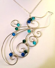 Image from http://orig13.deviantart.net/514f/f/2009/050/3/2/wire_art_peacock_necklace_by_earthjoules.jpg.