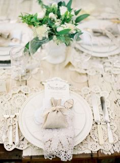 use all your beautiful linens in mix & match. Could use a bigger plain tablecloth with a too small beautiful vintage one on top.