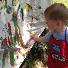 Outdoor craft time!!! Washable paints on an old bed sheet. The kids loved it and asked if we wash it and do it again!