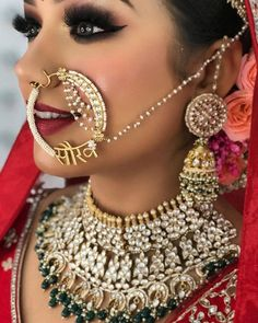 How pretty does this bride look with bold kundan jewellery set and earings. The custom nath design with the groom's name is a detail you cannot miss! (C) Makeup By Avipreet Bindra #wittyvows #indianwedding #indianweddingphotography #weddingideas #indianweddinginspiration #bridaljewellery #indianbride #indianbridaljewellery #weddingjewelryandaccessories Kundan Jewellery Set, Latest Jewellery, Gold Jewellery Design, South Indian Bride Jewellery, Bridal Accessories, Wedding Jewelry, Indian Bridal Photos, Gold Jhumka Earrings, Necklace Designs