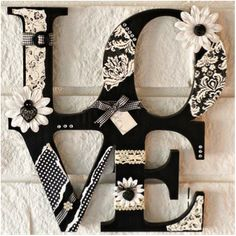 buy wooden letters, spray paint them, then glue flowers lace, etc. to make beautiful:)