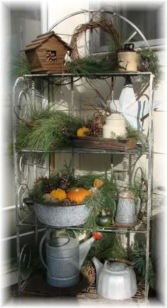 I've been looking for an idea for my garden shelf.  This is cute.