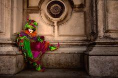 Carnival costumed model sitting outside San Gorgio church