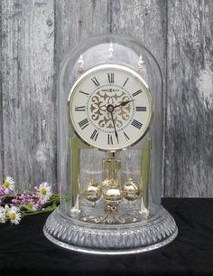 Vintage Germany Howard Miller Quartz Anniversary Clock With German Leaded Crystal Base $75.00